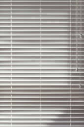 39892813 - background close up of closed wooden white venetian blinds